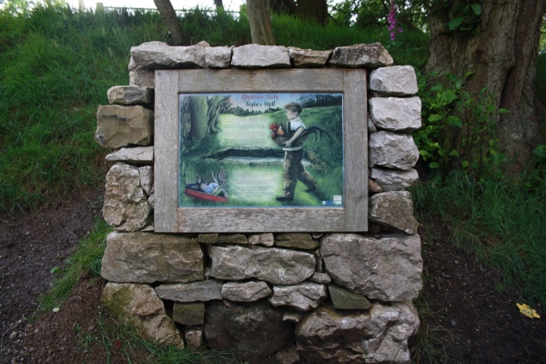 Interpretation board at St Tegla's Well